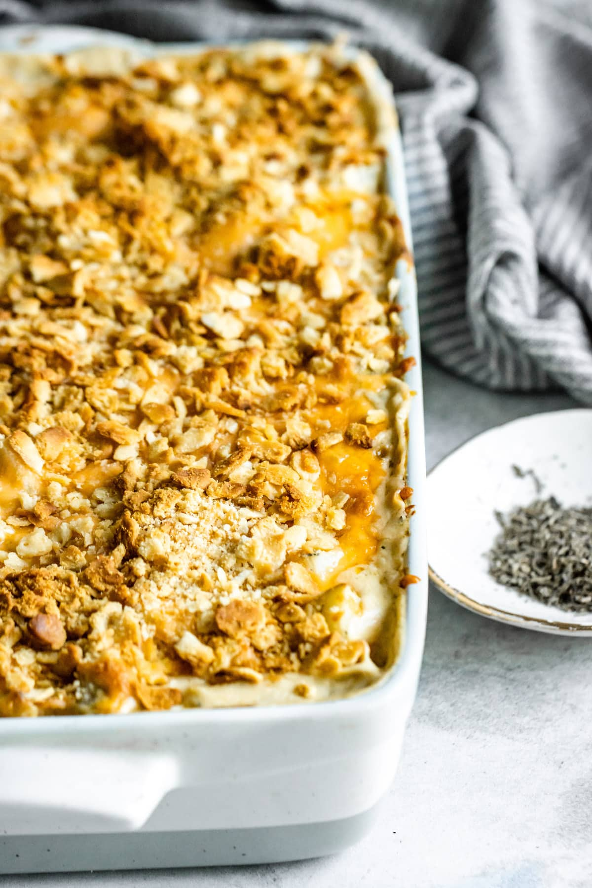 Hashbrown casserole topped with crushed croutons.