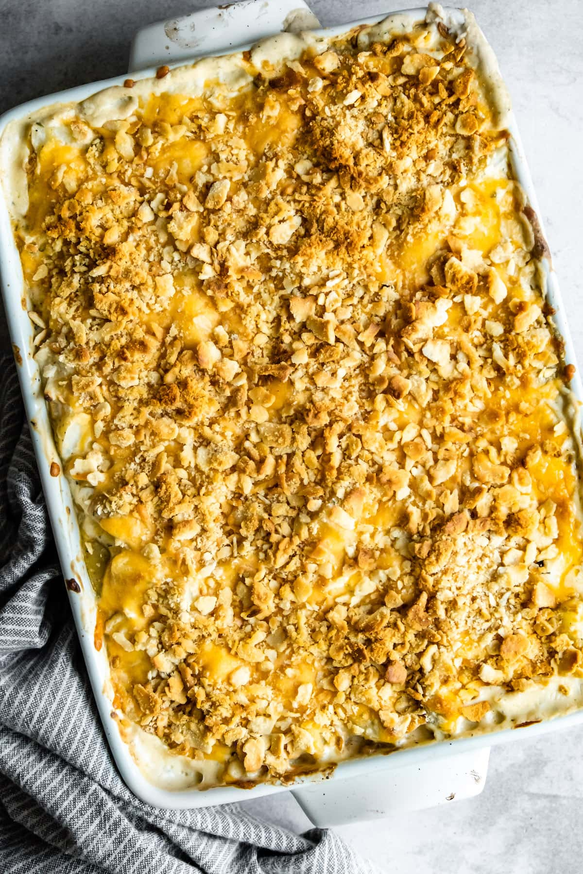 Baked hashbrown casserole in a pan.