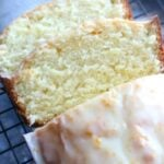 Slices of orange pound cake with orange zest glaze