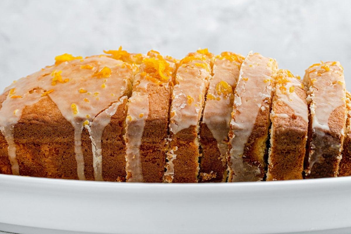 A loaf of orange pound cake with orange glaze.