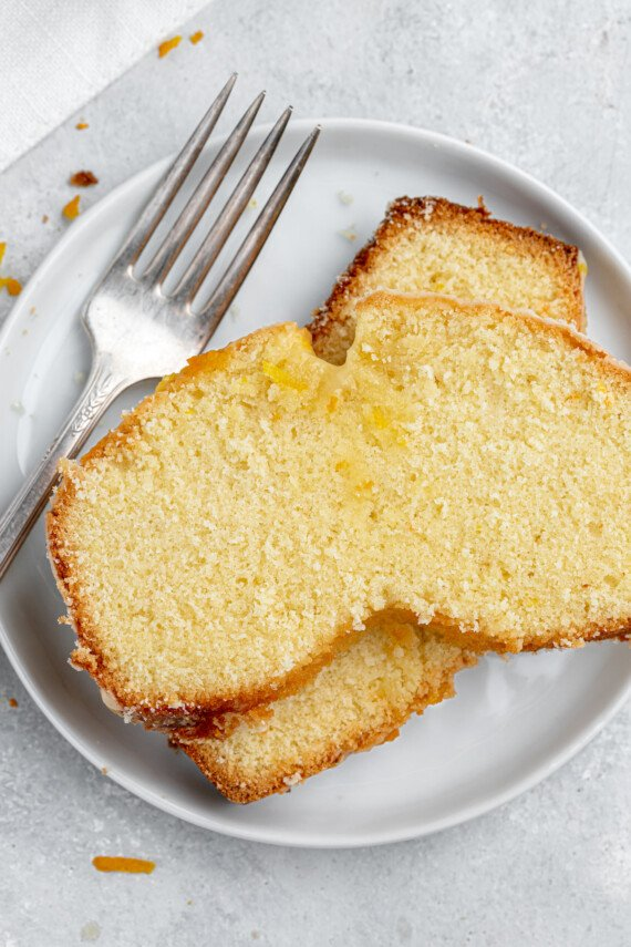 Two slices of pound cake on a plate.