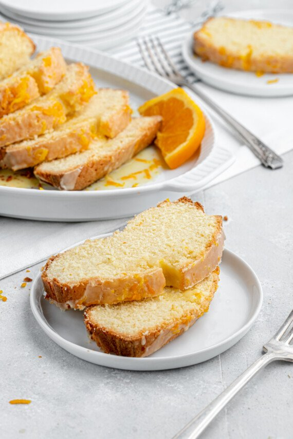 Two slices of cake with a fork.