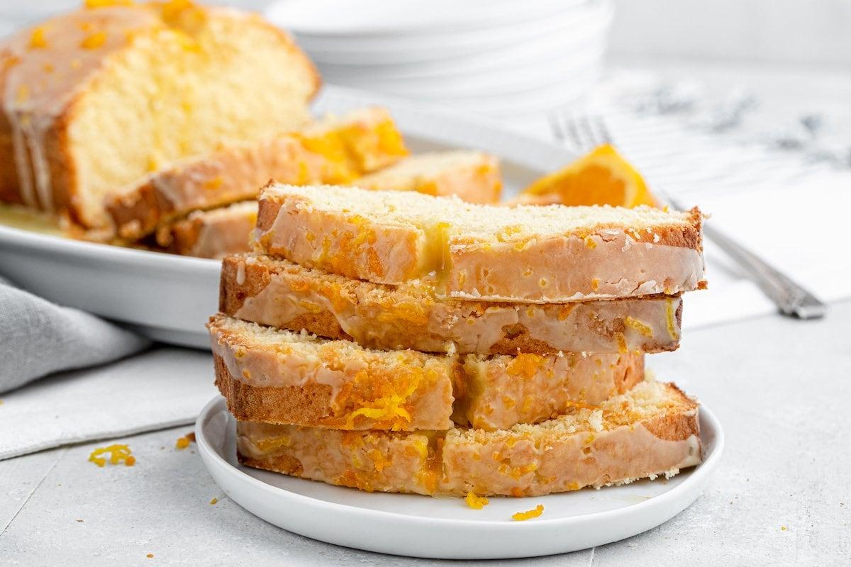 Glazed cake slices on a plate.