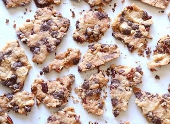 Chocolate Chip Cookie Brittle...insanely addictive crispy cookies. LIke the perfect buttery, salty edge in every bite! And it's made with turbinado sugar which helps it stay crisp!