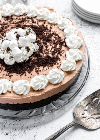 A no bake chocolate pie with whipped cream and an Oreo crust