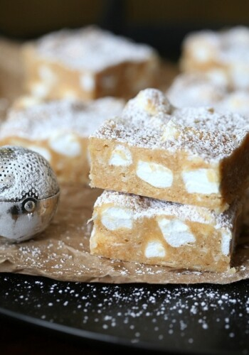 """These NO Bake """"Snow Drift Bars"""" are a delicious combination of a custard base mixed with crushed Nilla Wafers, coconut and marshmallows! They are so pretty, buttery and sweet!"""