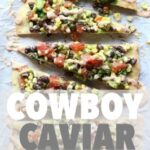 Overhead view of slices of Cowboy Caviar Pizza lined up on parchment paper