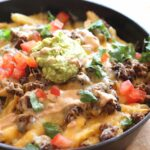 "These fun Skillet ""Frachos"" are Nacho Fries...crispy French Fries topped with all your Nacho favorites!!"