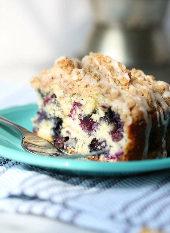 This Blueberry Muffin Cake is an ALL TIME favorite! It's soft, loaded with blueberries and topped with the best crunchy crumble!