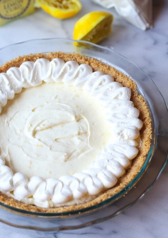 Lemon Cream Pie is a creamy pie recipe that is topped with lemon whipped cream