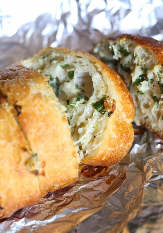 This Garlic Bread recipe is the best you will ever make...it's buttery, cheesy and LOADED with fresh garlic!