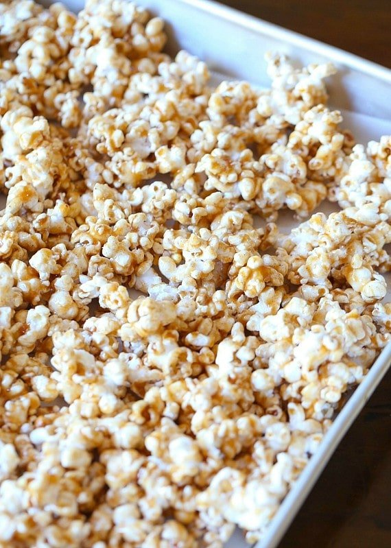 This Pumpkin Pie Spice Caramel Corn is crazy addictive....crunchy, sweet and seasoned with the perfect amount of Pumpkin Pie Spice and salt. Your fall snack for sure!