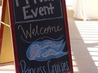 """An outdoor chalkboard sign reading """"private event, welcome Princess Cruises"""""""