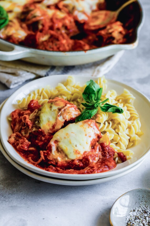 Plate of chicken parmesan with pasta.