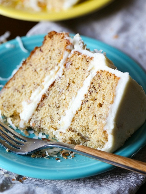 This slice of the best banana cake is three layers of moist, soft cake topped with creamy cream cheese frosting