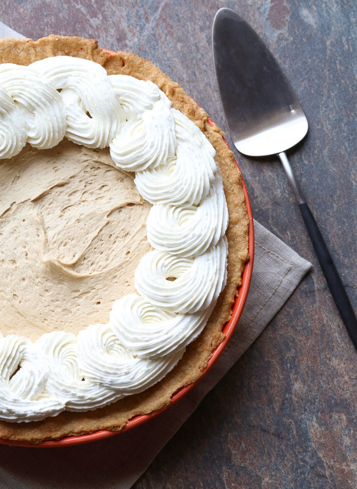 A Cookie Butter Pie with Cream Cheese Crust Beside a Metal Dessert Spatula