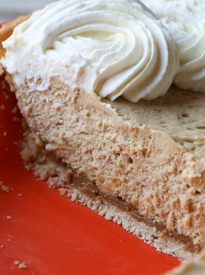 A Close-Up Shot of a Slice of Cookie Butter Pie with Cream Cheese Crust