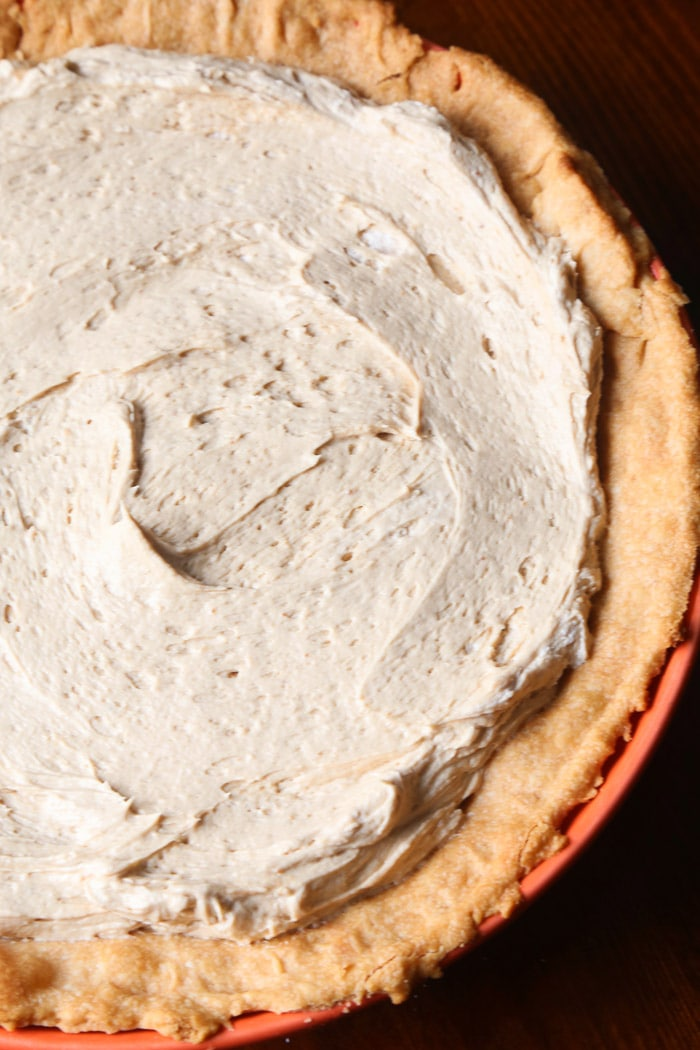 Cookie Butter Pie Filling Spread Onto a Baked Cream Cheese Crust
