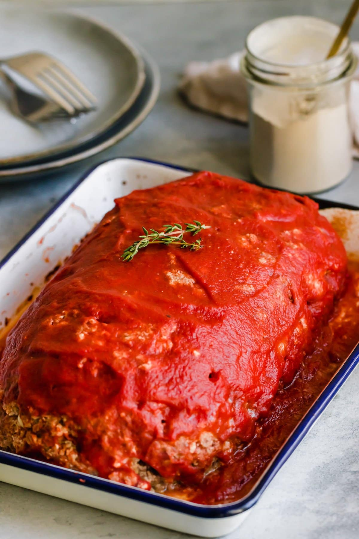 Pizza meatloaf with sauce in a pan.