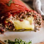 Pizza stuffed meatloaf with mozzarella cheese.