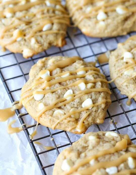 Bananas Foster Cookies... RIDICULOUSLY GOOD! Soft banana cookies, loaded with white chocolate and drizzled with Brown Sugar Rum sauce!