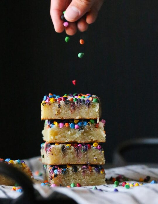 Rainbow Chip Blondies...no mixer required for these insanely buttery, chewy blondies topped with colorful rainbow chips...or even sprinkles!