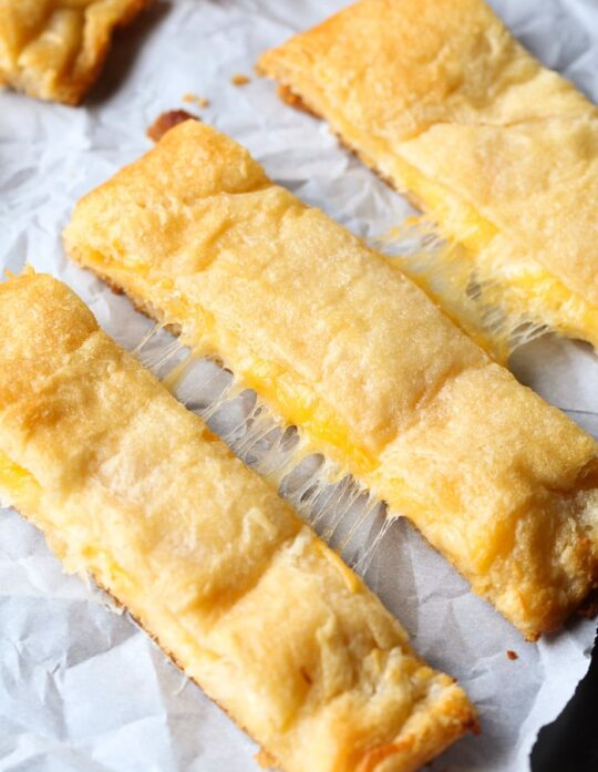 These are the Easiest CHEESIEST Breadsticks! So delicious and totally adaptable!
