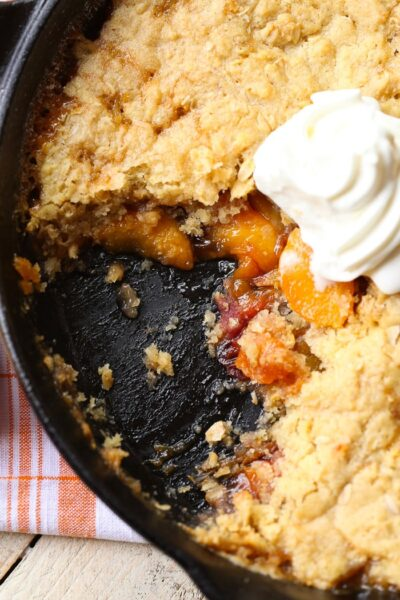 Skillet Sugar Cookie Peach Cobbler...a deliciously sweet peach cobbler topped with a sugar cookie and oat crumble!