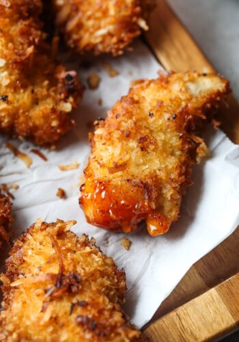 Crispy Coconut Chicken Strips with Sweet Chili Dipping Sauce!!! Such a quick and easy weeknight meal or amazing appetizer idea! My family LOVES THESE!!!