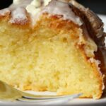 Slice of vanilla cake with white chocolate chips