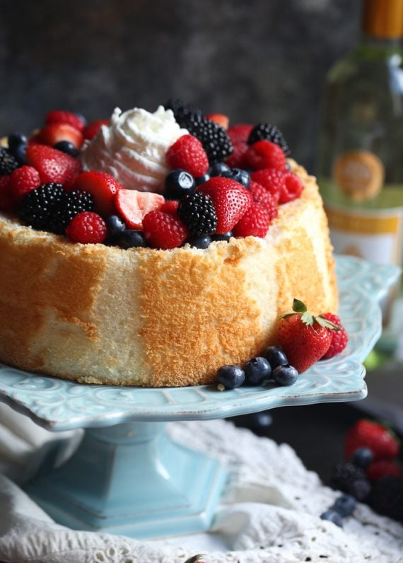 Angel Food Cake With Wine Soaked Berries Cookies And Cups