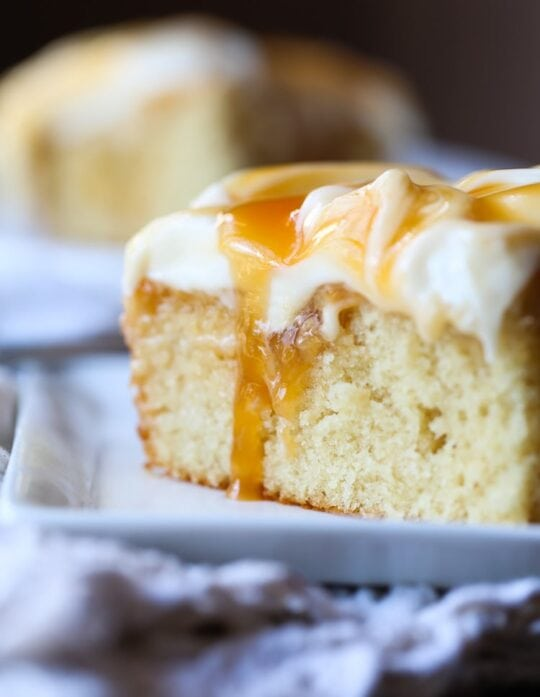 Quick and Easy Caramel Cake topped with creamy cream cheese frosting!