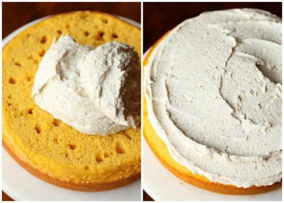 Assembling pumpkin cake with frosting