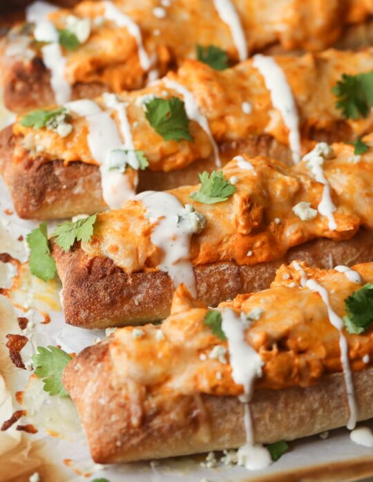Cheesy Buffalo Chicken Stuffed Bread...slice it small for a great appetizer, or slice it large for dinner sized sandwiches!