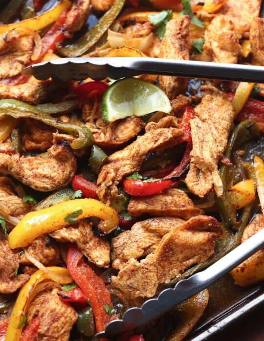 Sheet Pan Fajitas are such an easy and delicious weeknight dinner idea! They're done in under 30 minutes!