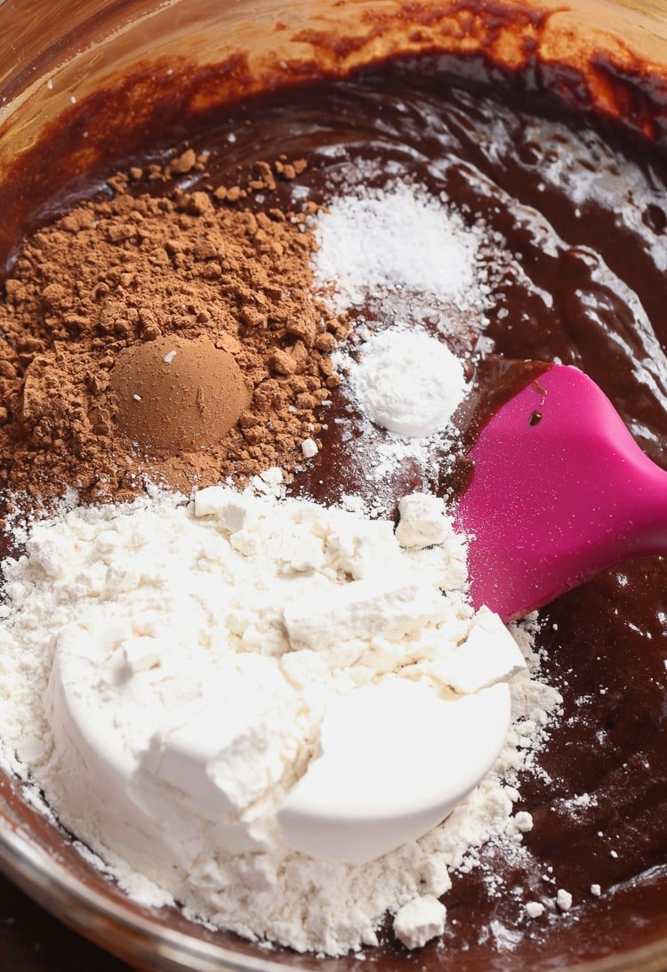 A Pink Dessert Spatula Mixing the Dry Ingredients Into the Cookie Batter