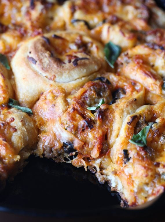 Pizza Rolls... everything you love about pizza, rolled up like a cinnamon roll! The perfect easy dinner or perfect Game Day snack!