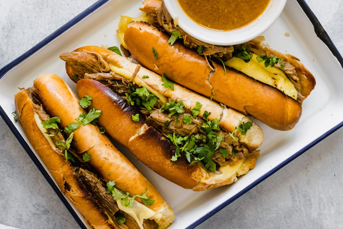 Three slow cooker French dip sandwiches.
