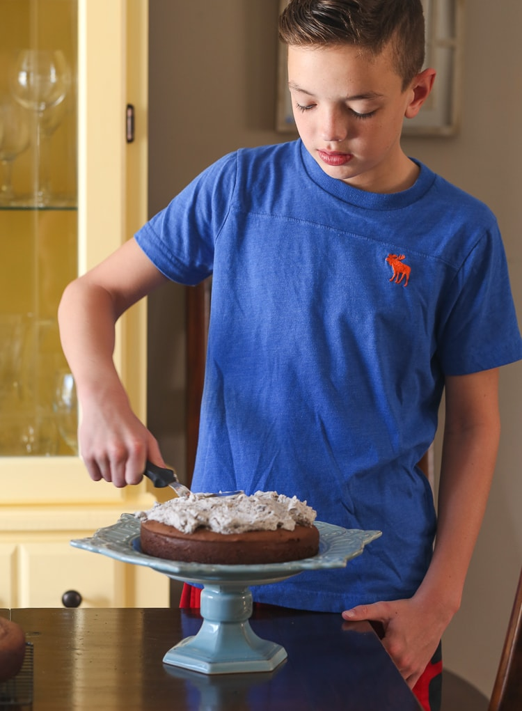 My Son Max Spreading a Thick Layer of Oreo Frosting Over a Layer of Chocolate Cake