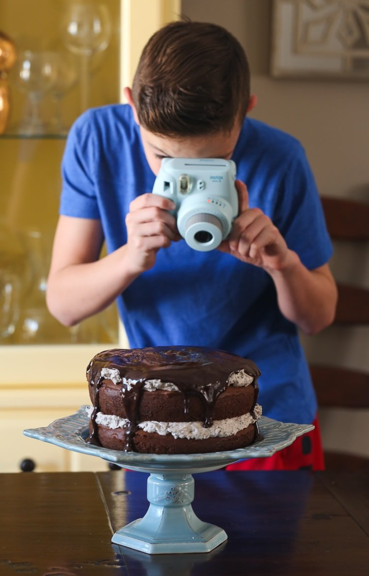 My Son Taking a Picture of Our Cookies and Cream Cake with His Polaroid Camera