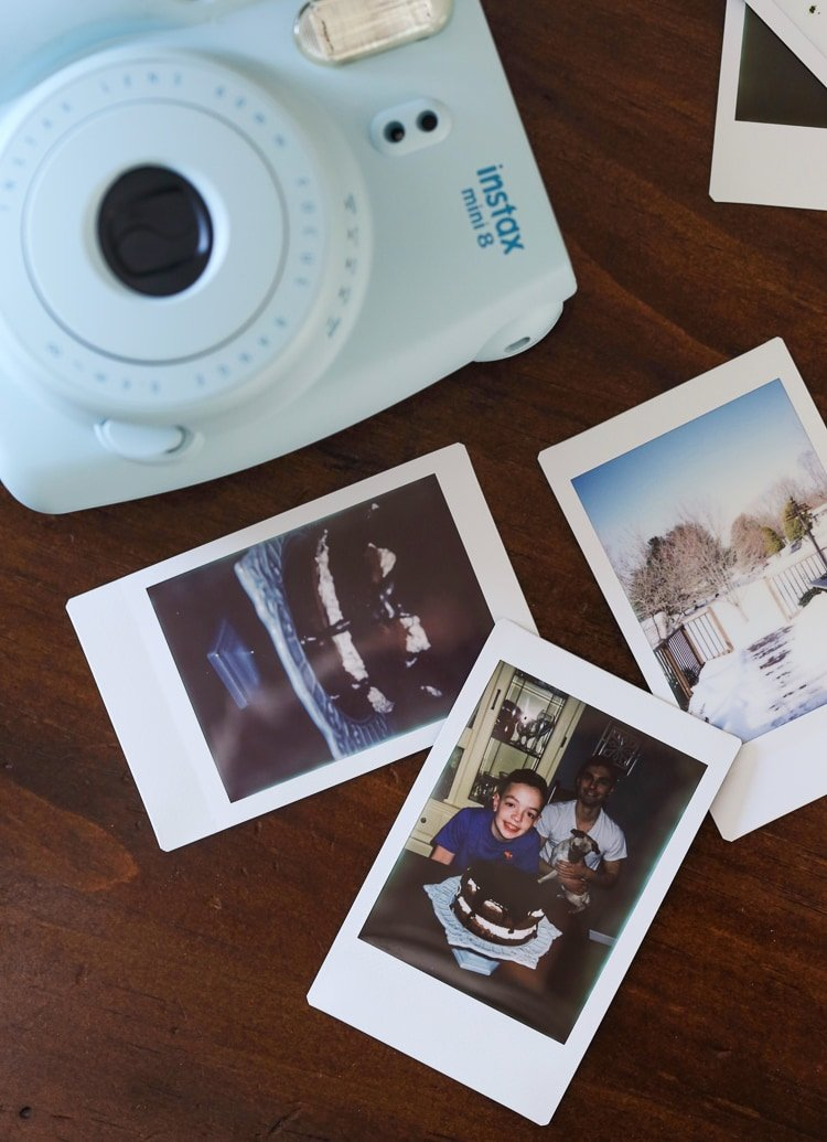 Max's Instax Photos of our Chocolate Cake with Oreo Frosting on a Wooden Table with His Polaroid Camera