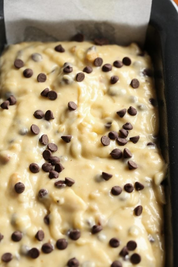 Chocolate chip banana bread batter in a pan ready to be baked.