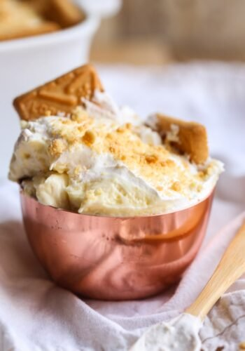 The BEST Banana Pudding Recipe ever! Served in a bowl with extra cookies!