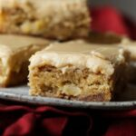 Plate of apple toffee blondies with brown sugar frosting