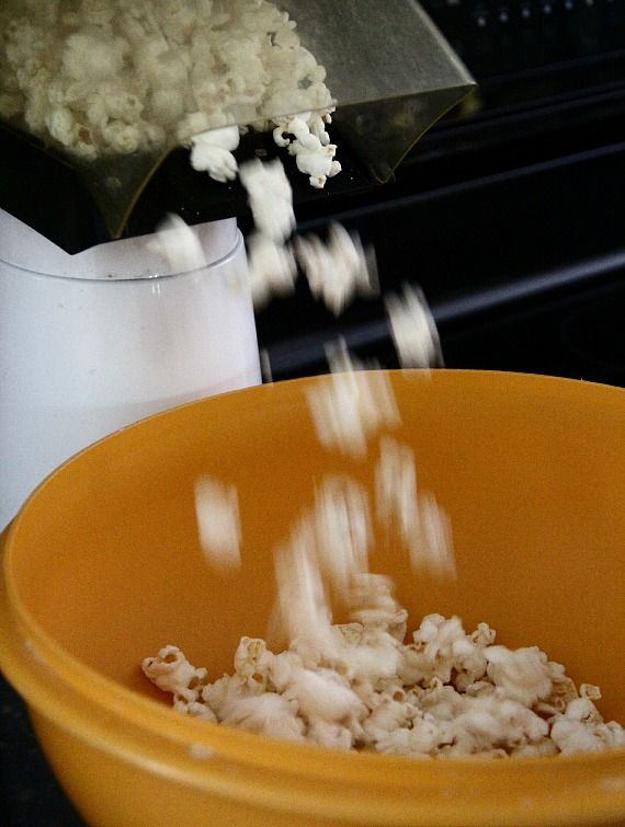 Image of Popped Popcorn Being Added to Bowl