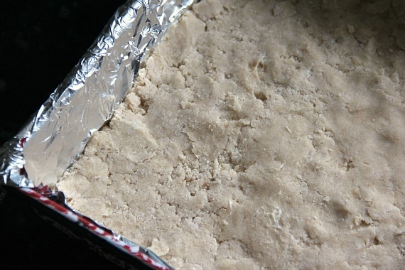 Crust batter pressed into a foil-lined baking pan