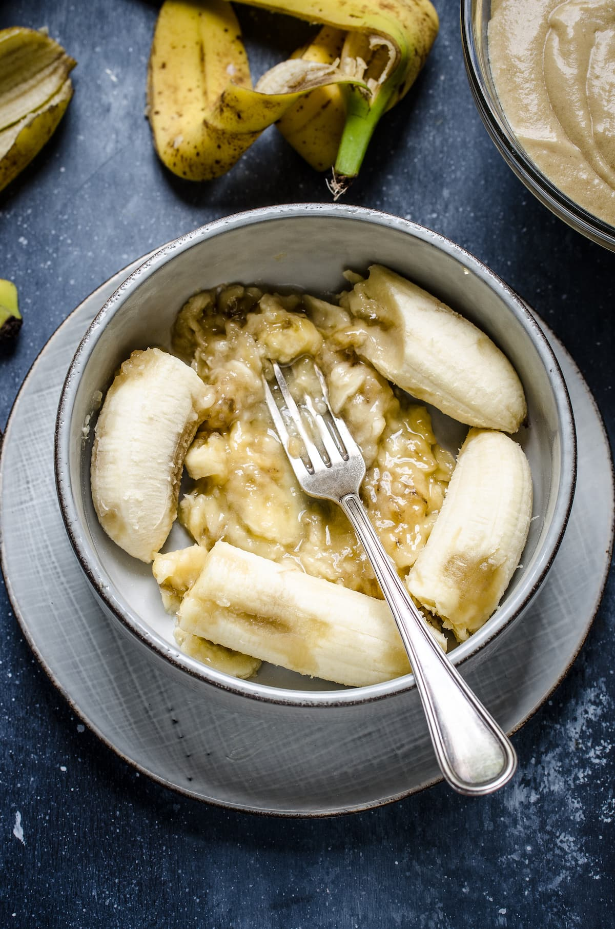 Mashing bananas with a fork in a bowl