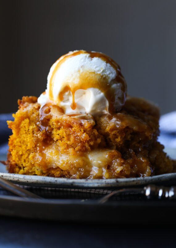 Pumpkin Dump Cake is deliciously sweet easy pumpkin cake recipe swirled with cream cheese and coconut.