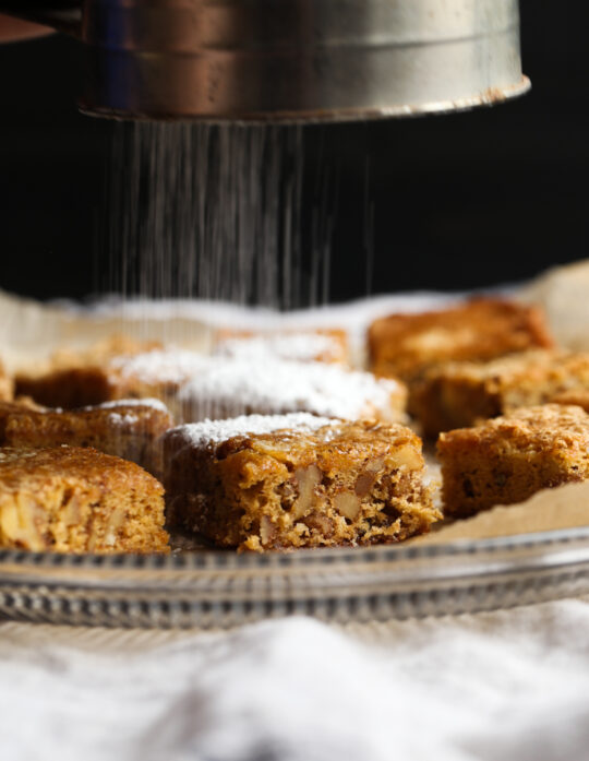 Classic Chewy Noels are a brown sugar cookie bars topped with powdered sugar