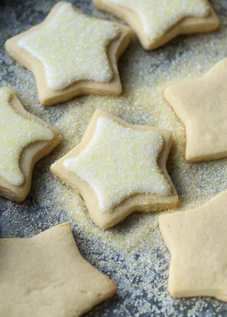 Decorated cut out sugar cookies with icing and sugar.
